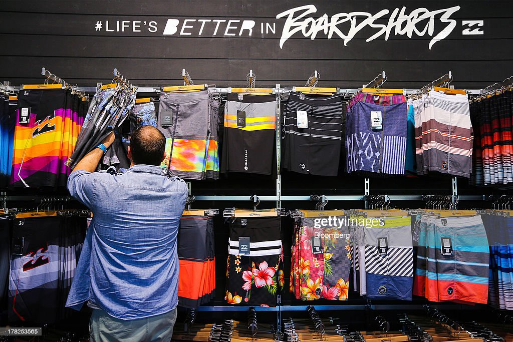 A customer browses merchandise inside a Billabong International Ltd. retail store at the company's headquarters in Burleigh Heads, Australia, on Wednesday, Aug. 28, 2013. Billabong, the surf brand founded in 1973, helped sell Australian surfing culture worldwide and rose to a market value of A$3.84 billion ($3.45 billion) at its peak in 2007 said its 40-year-old surf brand was worthless after the companys losses tripled amid store closures, firings and a breach of debt terms. Photographer: Patrick Hamilton/Bloomberg via Getty Images