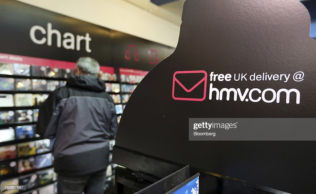 A customer browses music CDs in the 'chart' section of a HMV pop-up store in London, U.K., on Tuesday, Nov. 27, 2012. Fashion chain Hobbs is among those that have opened pop-up stores for the first time this year, while CD and DVD retailer HMV Group Plc is adding more than usual for the holiday in an effort to win business. Photographer: Chris Ratcliffe/Bloomberg via Getty Images