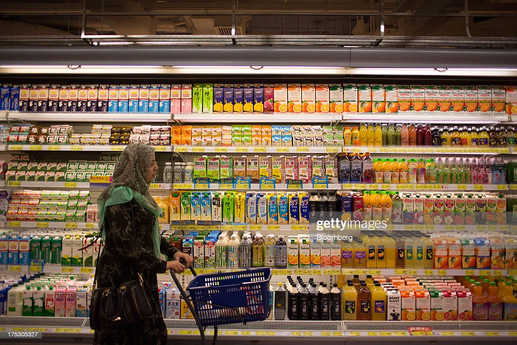 A customer browses packaged drinks in a ParknShop Superstore supermarket, operated by Hutchison Whampoa Ltd., in Hong Kong, China, on Thursday, Aug. 1, 2013. KKR & Co., the private-equity firm run by Henry Kravis and George Roberts, is evaluating a bid for Hong Kong supermarket chain ParknShop, according to two people with knowledge of the matter. Hutchison is seeking $3 billion to $4 billion for the chain and has asked potential buyers to submit bids by Aug. 16, people with knowledge of the process have said. Photographer: Lam Yik Fei/Bloomberg via Getty Images