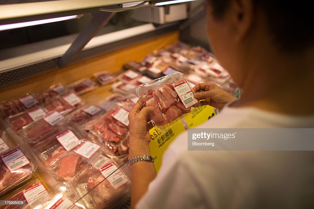 A customer browses packaged pork in a ParknShop Superstore supermarket, operated by Hutchison Whampoa Ltd., in Hong Kong, China, on Thursday, Aug. 1, 2013. KKR & Co., the private-equity firm run by Henry Kravis and George Roberts, is evaluating a bid for Hong Kong supermarket chain ParknShop, according to two people with knowledge of the matter. Hutchison is seeking $3 billion to $4 billion for the chain and has asked potential buyers to submit bids by Aug. 16, people with knowledge of the process have said. Photographer: Lam Yik Fei/Bloomberg via Getty Images