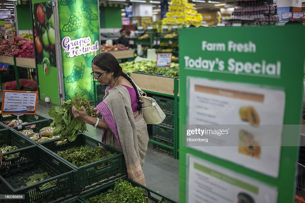 A customer browses produce in the vegetable section of the Big Bazaar Hypermarket store in Noida, India, on Monday, Sept. 9, 2013. Indias rupee fell, snapping the biggest four-day surge in 40 years, on concern slowing growth will deter inflows needed to reduce the current-account deficit. Photographer: Prashanth Vishwanathan/Bloomberg via Getty Images