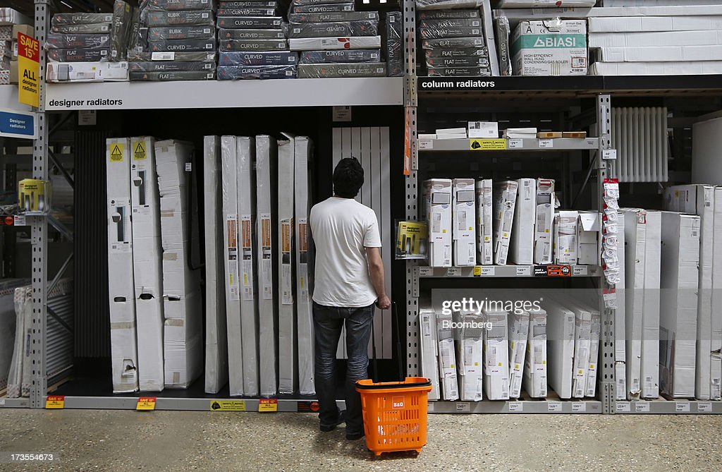 A customer browses radiators displayed for sale inside a B&Q home improvement store, operated by Kingfisher Plc, in London, U.K., on Tuesday, July 16, 2013. Financial assistance for first-time home buyers in Britain is likely to prompt a resurgence of do-it-yourself spending after several years of decline, according to Kingfisher Plc Chief Executive Officer Ian Cheshire. Photographer: Chris Ratcliffe/Bloomberg via Getty Images