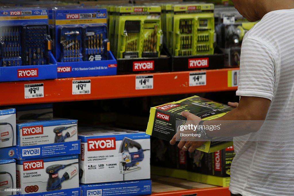 A customer browses Ryobi hardware tools while shopping at