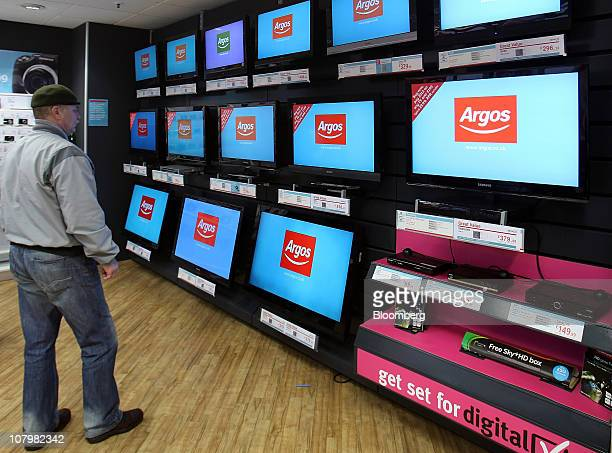 A customer browses televisions on display at an Argos store operated by Home Retail Group Plc in London UK on Tuesday Jan 11 2011 UK retail sales...