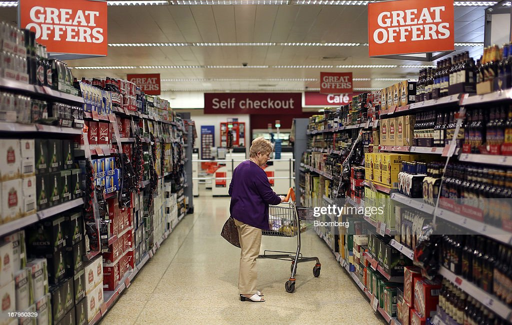 A customer browses the 'beers, wines and spirits' aisle inside a Sainsbury's supermarket store, operated by J Sainsbury Plc, in Godalming, U.K., on Thursday, May 2, 2013. J Sainsbury Plc, the U.K.'s third-largest supermarket chain, will report full year results on May 8. Photographer: Chris Ratcliffe/Bloomberg via Getty Images