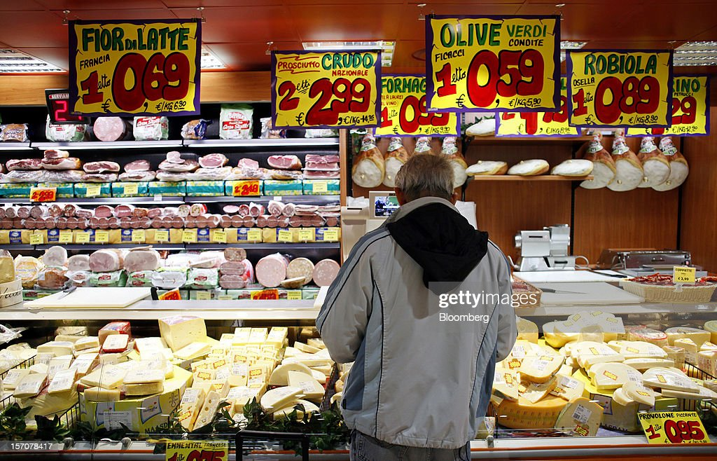 A customer browses the cheese and cured-meat section inside a OnePrice supermarket, operated by Gruppo BSE, in Monterotondo, Italy, on Wednesday, Nov. 28, 2012. Italy needs to uphold Prime Minister Mario Monti's pledge to shore up public finances in order to enjoy investor confidence even after elections due by April, the Organization for Economic Cooperation and Development said in its latest Economic Outlook report this week. Photographer: Alessia Pierdomenico/Bloomberg via Getty Images