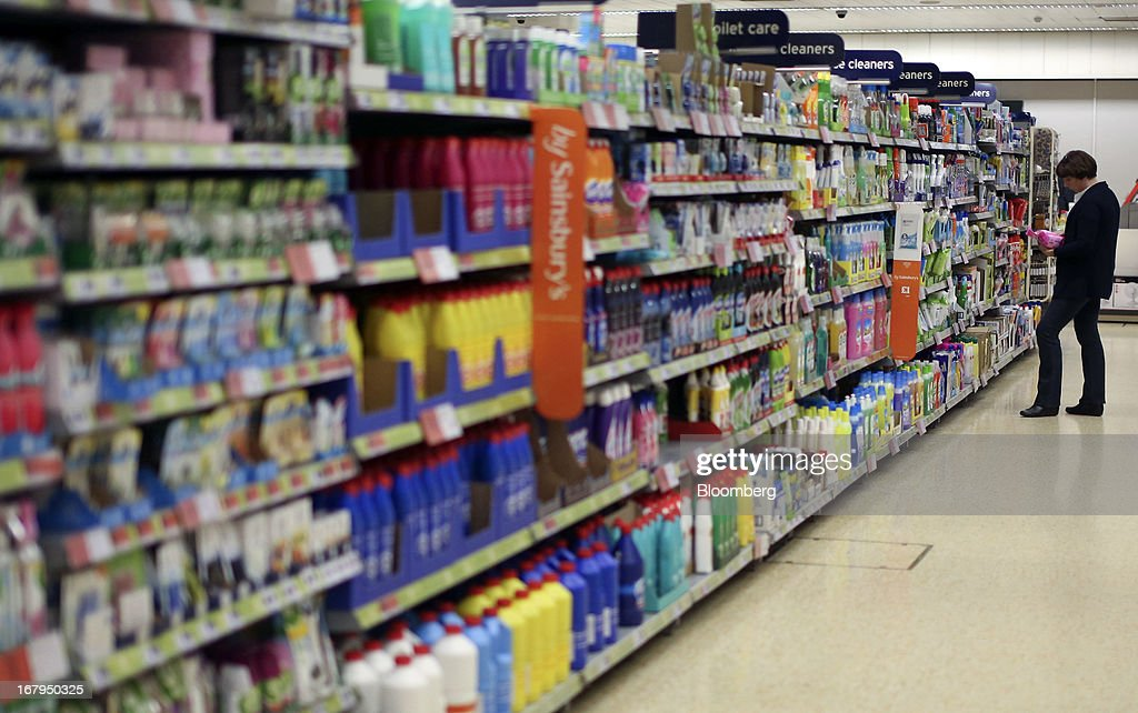A customer browses the cleaning products aisle inside a Sainsbury's supermarket store, operated by J Sainsbury Plc, in Godalming, U.K., on Thursday, May 2, 2013. J Sainsbury Plc, the U.K.'s third-largest supermarket chain, will report full year results on May 8. Photographer: Chris Ratcliffe/Bloomberg via Getty Images