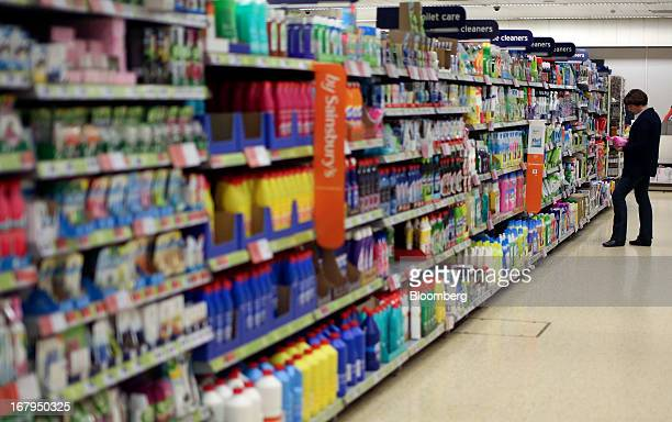 A customer browses the cleaning products aisle inside a Sainsbury's supermarket store operated by J Sainsbury Plc in Godalming UK on Thursday May 2...