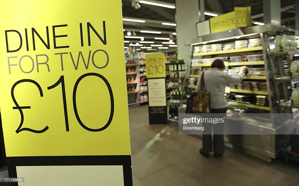 A customer browses the 'Dine In For Two for £10' display inside a Marks & Spencer Group Plc (M&S) food hall in the Westfield Stratford City retail complex in London, U.K., on Thursday, June 27, 2013. U.K. retail sales rose more than economists forecast in May as consumers spent more online and food sales increased at their fastest pace for more than two years. Photographer: Chris Ratcliffe/Bloomberg via Getty Images