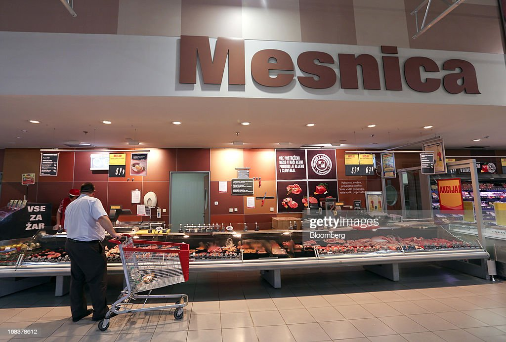 A customer browses the meat counter inside a Mercator Poslovni Sistem d.d. supermarket in Ljubljana, Slovenia, on Wednesday, May 8, 2013. In January Mercator reported its first full-year loss in fifteen years as the largest supermarket chain's sales in the Balkans last year suffered during the recession. Photographer: Chris Ratcliffe/Bloomberg via Getty Images