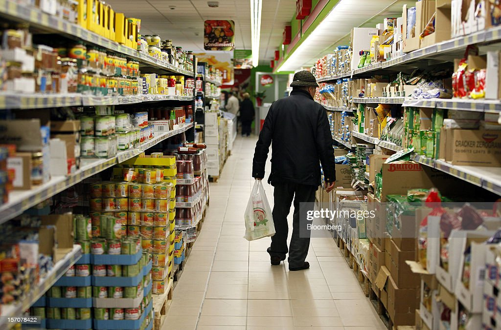 A customer browses the pasta section inside a OnePrice supermarket, operated by Gruppo BSE, in Monterotondo, Italy, on Wednesday, Nov. 28, 2012. Italy needs to uphold Prime Minister Mario Monti's pledge to shore up public finances in order to enjoy investor confidence even after elections due by April, the Organization for Economic Cooperation and Development said in its latest Economic Outlook report this week. Photographer: Alessia Pierdomenico/Bloomberg via Getty Images