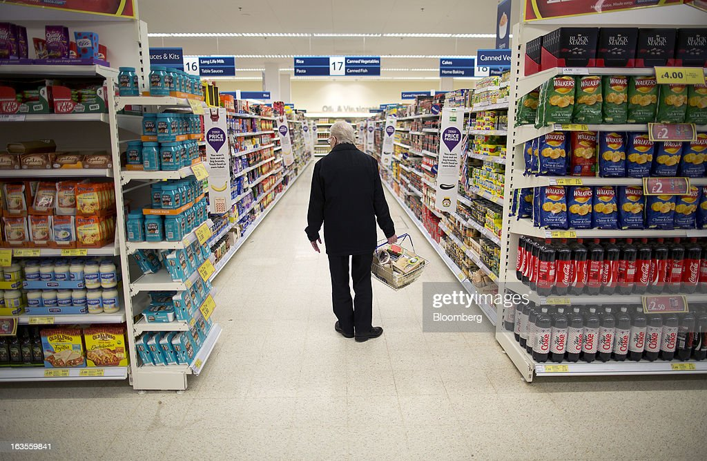 A customer browses tinned goods on display inside a Tesco Plc supermarket in the borough of Kensington in London, U.K., on Tuesday, March 12, 2013. Tesco Plc, the U.K.'s largest grocer launched a 'Price Promise', its latest initiative offering to match the price of customers' purchases to that of it's rivals, including Wal-Mart Stores Inc.'s ASDA. Photographer: Simon Dawson/Bloomberg via Getty Images
