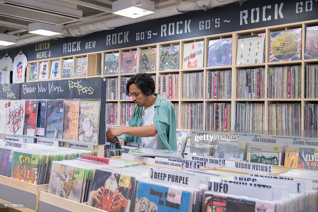 A customer browses vinyl records at the HMV Record Shop operated by Lawson HMV Entertainment Inc. in the Shibuya district of Tokyo, Japan, on Wednesday, Sept. 28, 2016. Spotify Ltd. is bringing its popular online music service to Japan, a large and lucrative market where fans have demonstrated a continuing fondness for CDs and even vinyl records. Photographer: Noriko Hayashi/Bloomberg via Getty Images