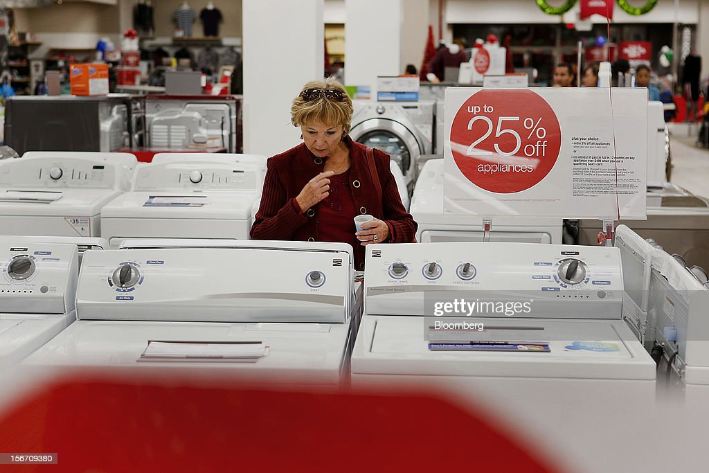 A customer browses washing machines at a Sears store during the Family and Friends evening sale inside the Del Amo shopping mall in Torrance, California, U.S., on Sunday, Nov. 11, 2012. Sears Holdings Corp., the retailer controlled by hedge-fund manager Edward Lampert, fell the most in more than 10 months on Nov. 16, after posting a wider third-quarter loss and its 23rd straight quarterly sales decline. Photographer: Patrick Fallon/Bloomberg via Getty Images