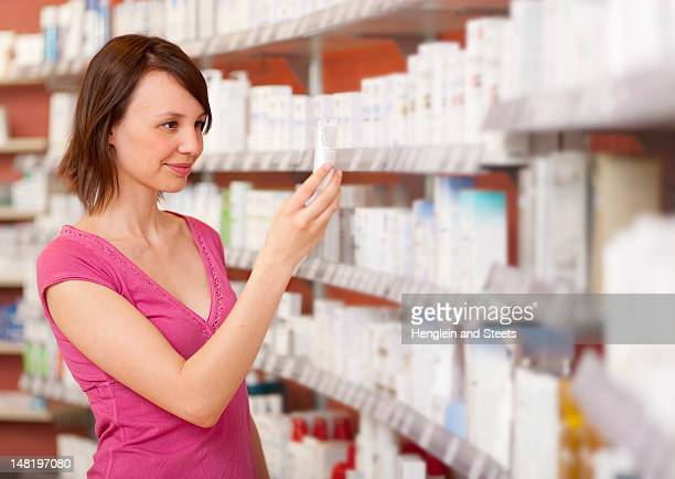 Customer browsing on drugstore shelves