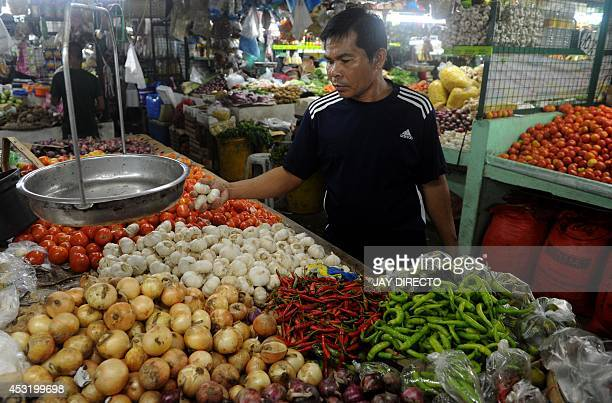 A customer buy garlic at a market in Manila on August 5 2014 Philippine inflation shot up to a nearly threeyear high of 49 percent in July the...