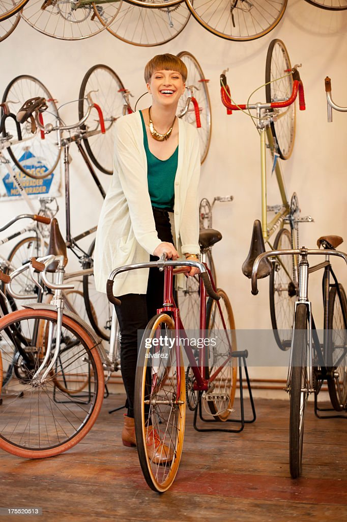 Customer buying bicycle in a bike store : Stock Photo