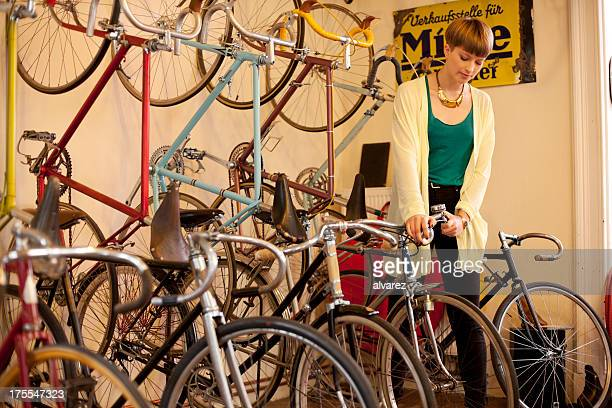 Customer buying bicycle in a bike store