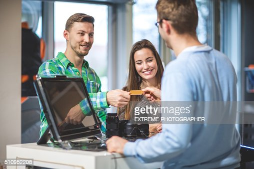 Customer buying photographic equipment