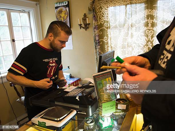 A customer buys a marijuana joint at a dispensary in Eugene Oregon on March 22 2016 Legal marijuana is becoming more and more entrenched in the...