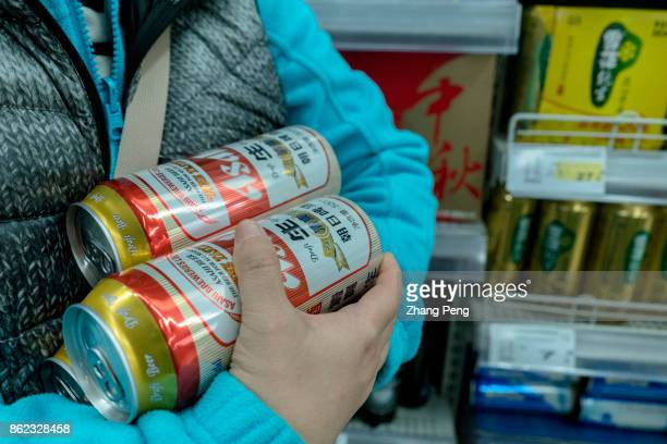 Customer buys Asahi beer in a Chinese supermarket On Oct12th Asahi Group announced that it would transfer the stake in China's second largest beer...