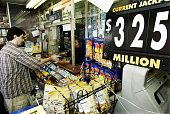 A customer buys Big Game Lottery tickets for the drawing of the $325 million jackpot at a newsstand located near the PATH commuter train station...