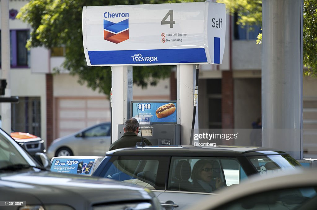 A customer buys fuel at a Chevron Corp. gasoline station in San Francisco, California, U.S., on Friday, April 6, 2012. Gasoline slid to a four-week low as slower job growth in the U.S. and accelerating inflation in China raised concern that global demand for fuel may shrink. Photographer: David Paul Morris/Bloomberg via Getty Images