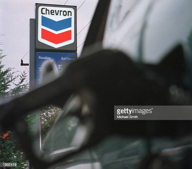 A customer buys gasoline at a Chevron gas station October 16 in Arlington VA Chevron Corp plans to buy smaller rival Texaco Inc for about $33 billion...