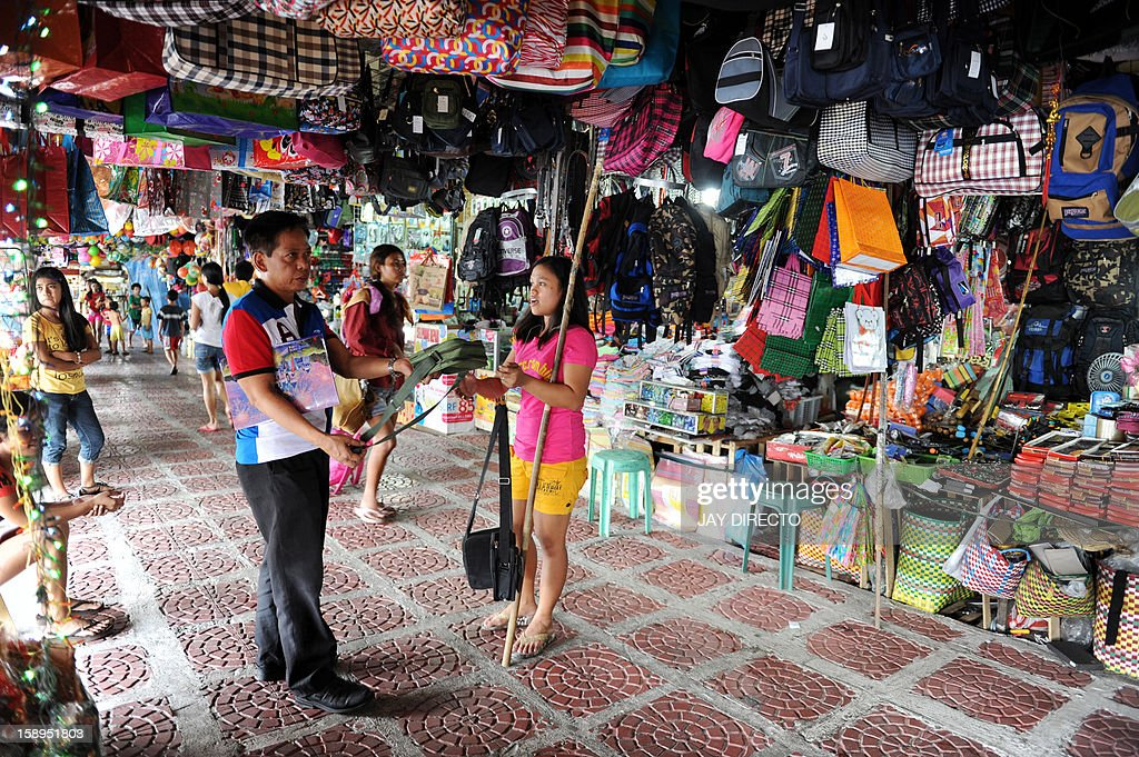 A customer buys goods at a general merchandise store in Manila on January 4, 2013. The Philippines' inflation rate fell to a five-year low last year, the government said Friday, helping efforts to hold down interest rates and boost economic growth. Consumer prices expanded by 3.2 percent for the entire 2012, substantially lower than the 4.6 percent recorded in 2011, the National Statistics Office said.
