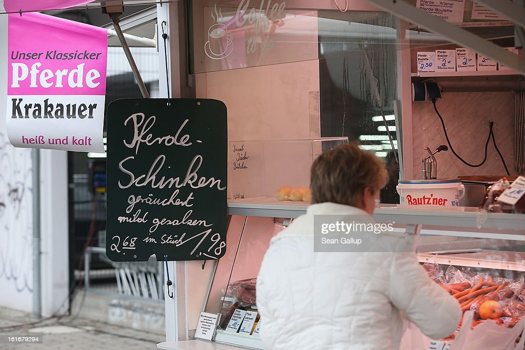 A customer buys ham at the Schlemmer Hansel stand, which sells products made from horsemeat as well as pork and beef, at the weekly open-air market in Hohenschoenhausen district on February 14, 2013 in Berlin, Germany. While authorites arcoss Europe investigate the origin of ready-made lasagne that was labeled to contain only beef when it in fact also contained horsemeat, fans of horsemeat are pointing to its good taste and its health benefits. Horsemeat contains significantly less fat than beef and has slightly higher protein.