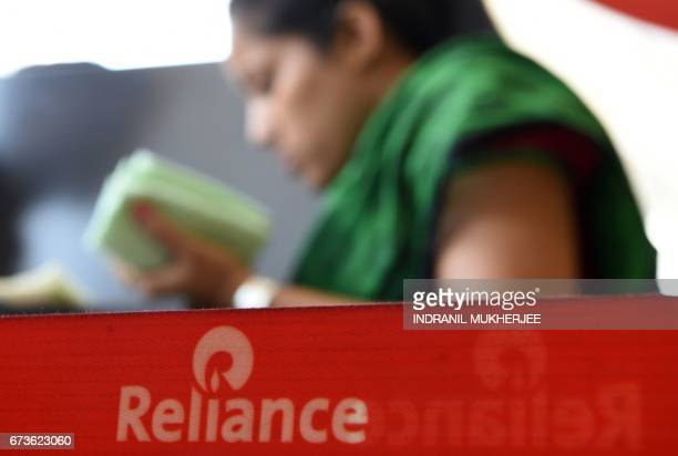 A customer buys Reliance Jio services at a Reliance Digital store in Mumbai on April 21 2017 Indian conglomerate Reliance Industries exceeded...