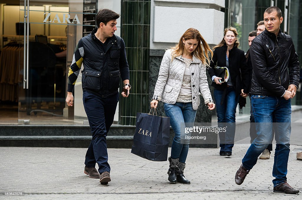 A customer carries a branded shopping bag as she exits a Zara fashion store, operated by Inditex SA, in Budapest, Hungary, on Wednesday, Oct. 2, 2013. 'The retail sales environment in Europe, especially in Spain, has become less challenging in the last few weeks, while the weather overall has also been more stable,' Anne Critchlow, a London-based analyst at Societe Generale, said. Photographer: Akos Stiller/Bloomberg via Getty Images