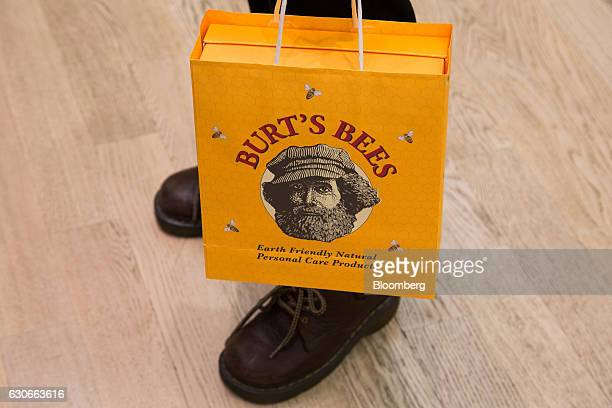 A customer carries a branded shopping bag at a Burt's Bees Inc store a subsidiary of Clorax Co in Seoul South Korea on Thursday July 2 2015 At a time...