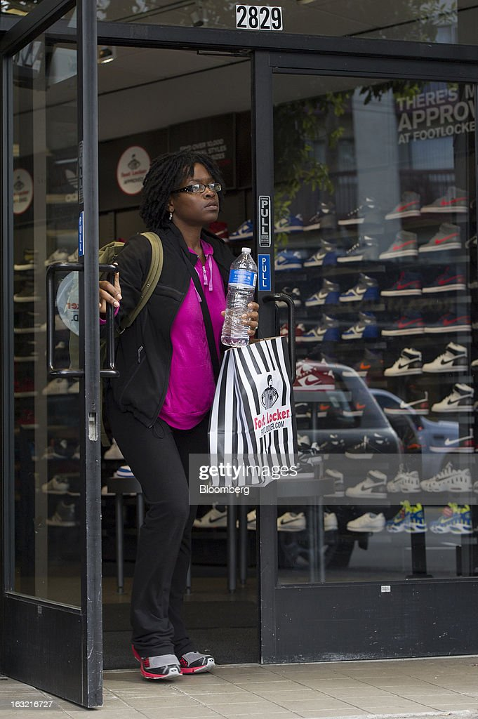 A customer carries a Foot Locker Inc. shopping while exiting a store in San Francisco, California, U.S., on Tuesday, March 5, 2013. Foot Locker Inc. is expected to release earnings data on March 8. Photographer: David Paul Morris/Bloomberg via Getty Images