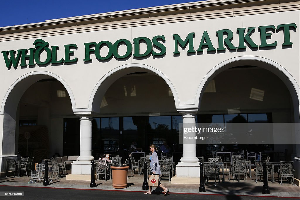 A customer carries a shopping bag outside of a Whole Foods Market Inc. location in El Segundo, California, U.S., on Tuesday, Nov. 5, 2013. Whole Foods Market Inc. is scheduled to release earnings figures on Nov. 6. Photographer: Patrick T. Fallon/Bloomberg via Getty Images