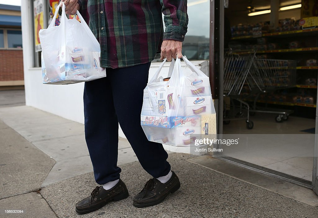 A customer carries bags of Hostess products at a Wonder Hostess Bakery Outlet on November 16, 2012 in San Leandro, California. Hostess Brands, the maker of Twinkies, Ding Dongs and Wonder Bread, announced plans to liquidate its assets and lay off nearly 18,500 employees due to a workers strike brought on by an imposed contract that would cut workers' wages by 8 percent.