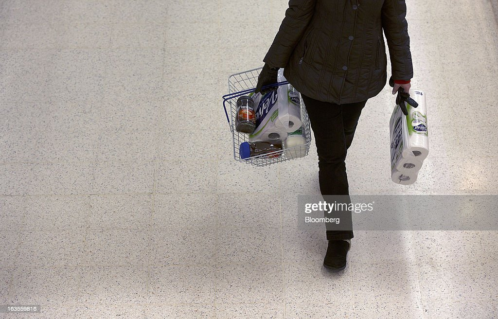 A customer carries her basket of shopping inside a Tesco Plc supermarket in the borough of Kensington in London, U.K., on Tuesday, March 12, 2013. Tesco Plc, the U.K.'s largest grocer launched a 'Price Promise', its latest initiative offering to match the price of customers' purchases to that of it's rivals, including Wal-Mart Stores Inc.'s ASDA. Photographer: Simon Dawson/Bloomberg via Getty Images