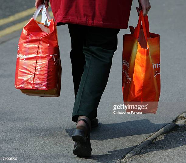A customer carries her new Sainsbury's 'Bag for Life' on April 27 2007 in Northwich Cheshire Supermarket chain Sainsbury's is not giving out any...