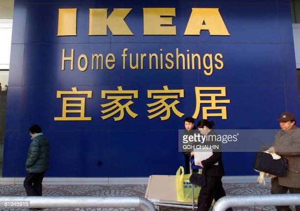 A customer carries her purchases as she leaves Ikea's new Beijing store 27 January The home furnishings store is the latest crowdpuller in Beijing...