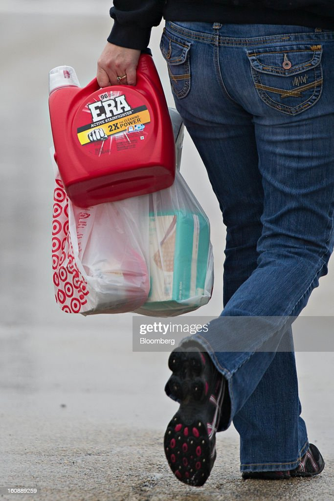 A customer carries purchases outside a Target Corp. store in Peru, Illinois, U.S., on Thursday, Feb. 7, 2013. Target Corp. led U.S. retailers to the biggest monthly same-store sales gain in more than a year as shoppers snapped up discounted merchandise chains were clearing out after the holidays. Photographer: Daniel Acker/Bloomberg via Getty Images