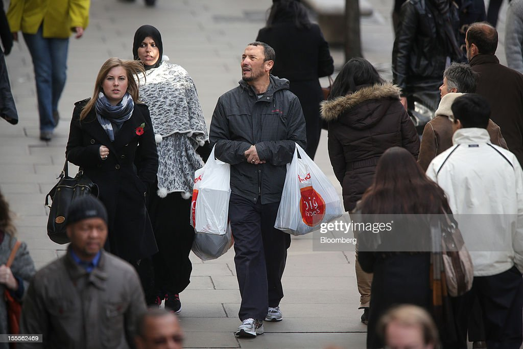 A customer carries TK Maxx shopping bags along Oxford Street in central London, U.K., on Monday, Nov. 5, 2012. Britain exited a double-dip recession in the third quarter with the strongest growth in five years as Olympic ticket sales and a surge in services helped boost the rebound. Photographer: Jason Alden/Bloomberg via Getty Images