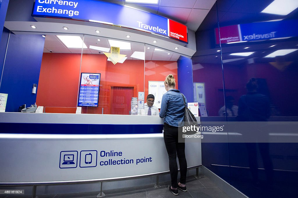 A customer changes currency at a Travelex UK Ltd. currency exchange in London, U.K., on Monday, Aug. 24, 2015. European stocks rallied with U.S. equity-index futures after Monday's $2.7 trillion global equity wipeout, while the yen retreated with gold. Photographer: Jason Alden/Bloomberg via Getty Images