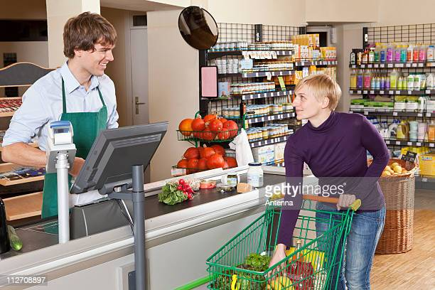 A customer checking out in a supermarket