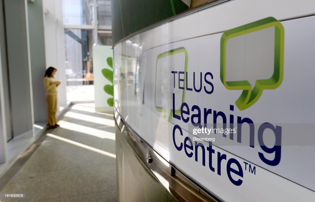 A customer checks her mobile device at a Telus Corp. learning center and store in Toronto, Ontario, Canada, on Wednesday, Feb. 13, 2013. Telus Corp. is scheduled to release earnings data on Feb. 15. Photographer: Aaron Harris/Bloomberg via Getty Images