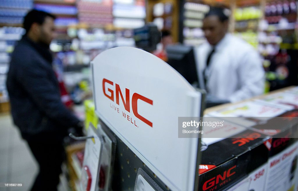A customer checks out at a GNC Holdings Inc. store in New York, U.S., on Thursday, Feb. 14, 2013. GNC Holdings Inc., a retailer of health and wellness products, reported revenue increases of 10.9% in the fourth quarter and 17.3% for the full year. Photographer: Jin Lee/Bloomberg via Getty Images