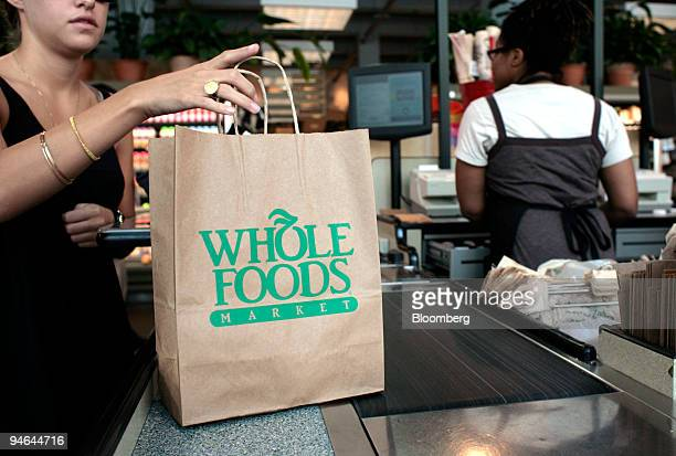 A customer checks out of a Whole Foods Market in Washington DC Aug 17 2007 Wild Oats Markets Inc rose the most in more than five years after a judge...