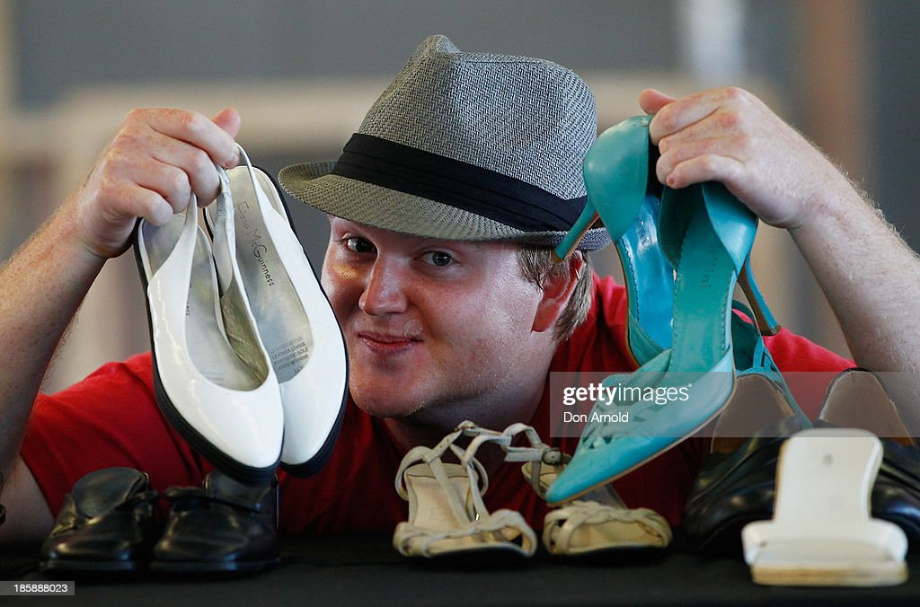 A customer checks out shoes at the AHM Fashion Exchange at The Overseas Passenger Terminal on October 26, 2013 in Sydney, Australia.