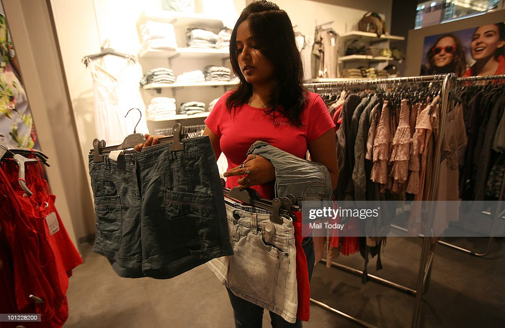 A customer checks out shorts at the Pramod store at Select Citywalk in New Delhi on May 26, 2010.