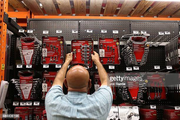 A customer checks out the tools at a Home Depot on August 18 2015 in Miami Florida Today Home Depot shares rose as the company reported secondquarter...
