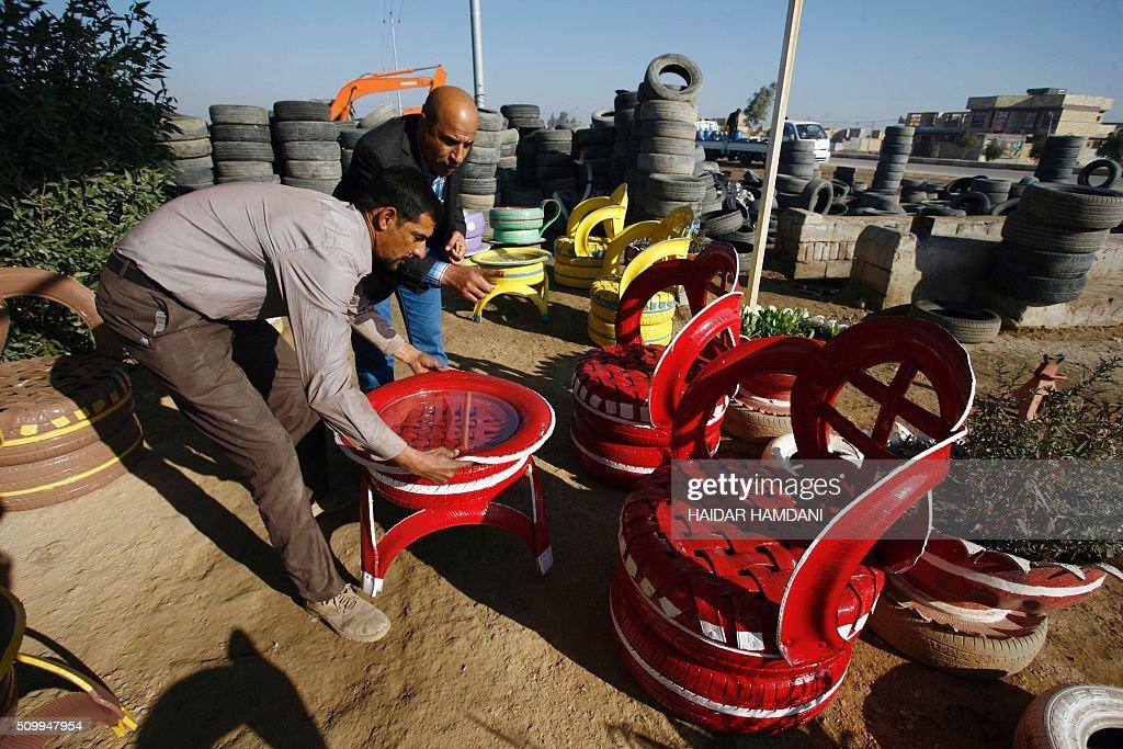 A customer checks the chairs at Abu Haidar's tire repair shop, where he transforms unused tires into furniture, in the Diwaniya village, east of the holy Iraqi city of Najaf, on February 13, 2016. / AFP / HAIDAR HAMDANI